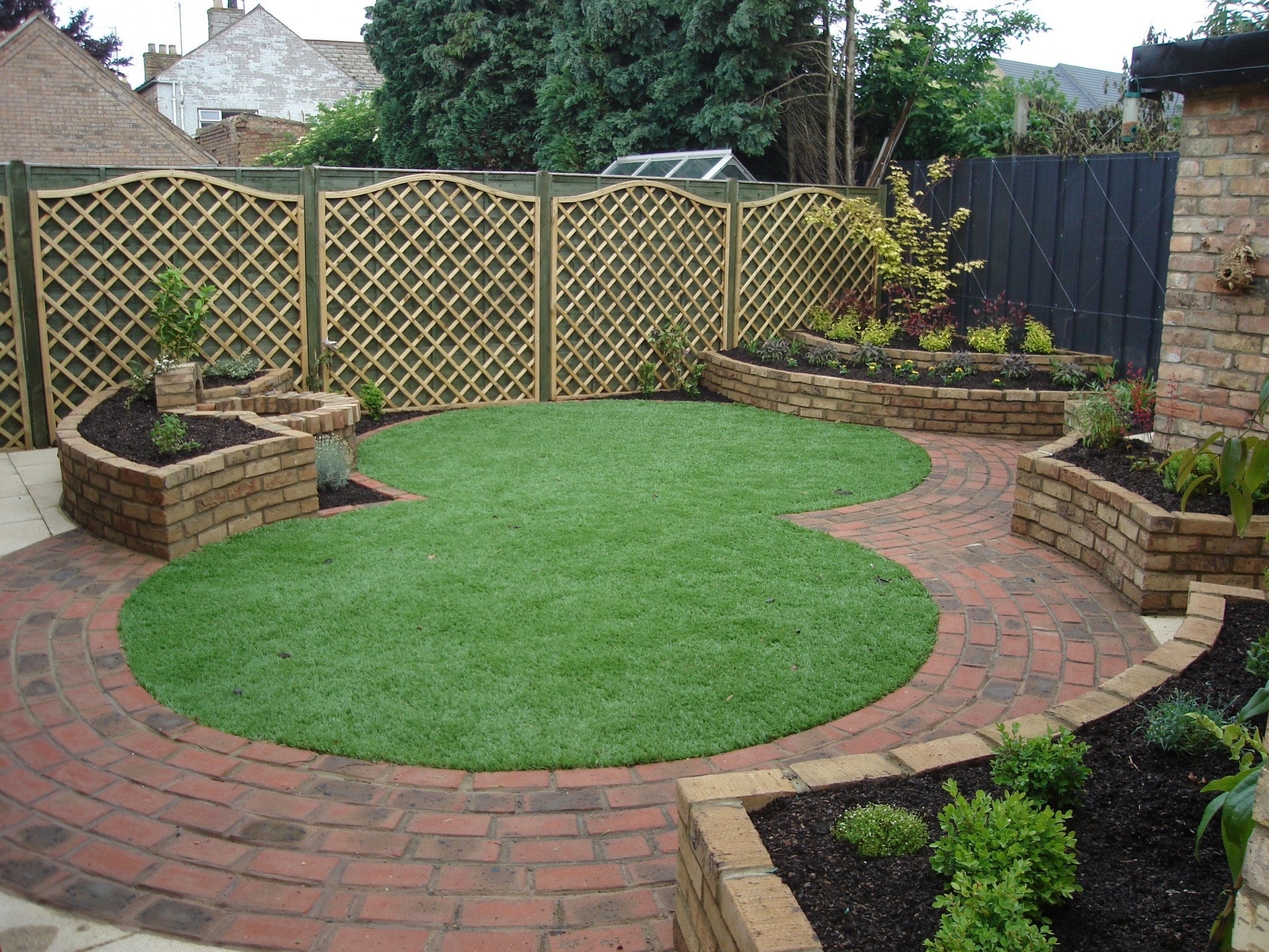 Low maintenance design with artificial grass in March, Cambridgeshire