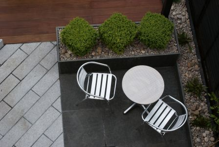 Contemporary garden design  in hardwood and granite