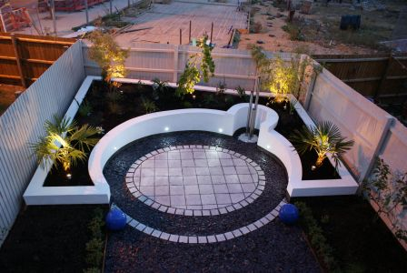 Modern garden with white raised beds in Peterborough, Cambridgeshire