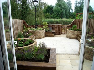 Paved garden with raised beds