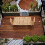 Dark wood contrasts with white granite paving