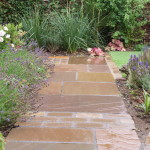 Another pathway bordered with planting to soften the lines