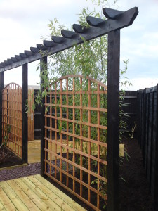 The trellis screen masking the shed and wheelie bin area