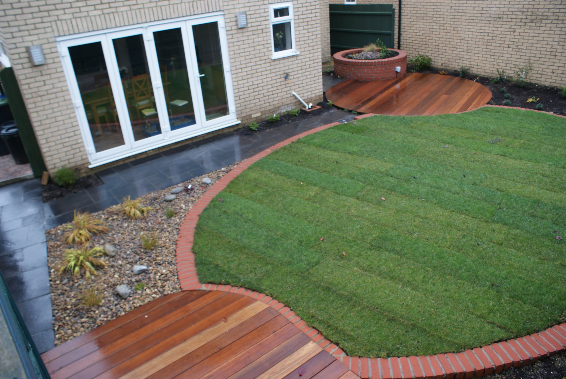 Circular garden design with hardwood decking in Ely