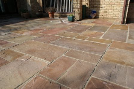 patio lifted cleaned and relaid after poor job by previous landscapers